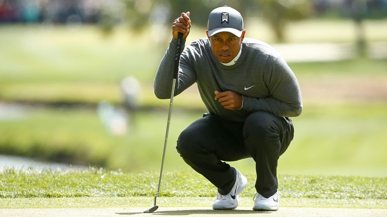 Woods mixed five birdies with four bogeys in his 70
