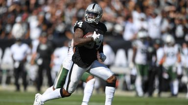 Cordarrelle Patterson #84 of the Oakland Raiders scores on a 43 yard touchdown run against the New York Jets