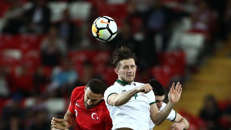 Republic of Ireland's Alan Browne (right) and Turkey's Cenk Tosun (left) battle for the ball during the international friendly match at the Antalya Stadium. PRESS ASSOCIATION Photo. Picture date: Friday March 23, 2018. See PA story SOCCER Turkey. Photo credit should read: Tim Goode/PA Wire. RESTRICTIONS: Editorial use only, No commercial use without prior permission.