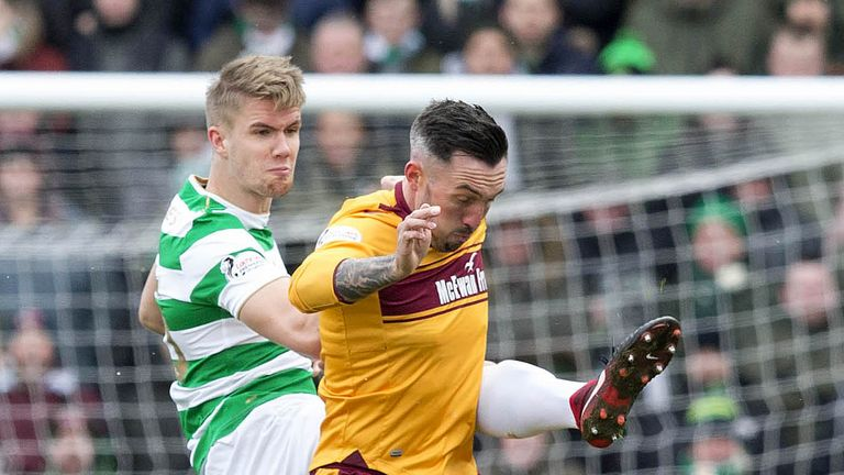 Celtic's Kristoffer Ajer and Motherwellss Ryan Bowman battle for the ball during the Ladbrokes Scottish Premiership match at Fir Park, Motherwell. PRESS ASSOCIATION Photo. Picture date: Sunday March 18, 2018. See PA story SOCCER Motherwell. Photo credit should read: Jeff Holmes/PA Wire. EDITORIAL USE ONLY