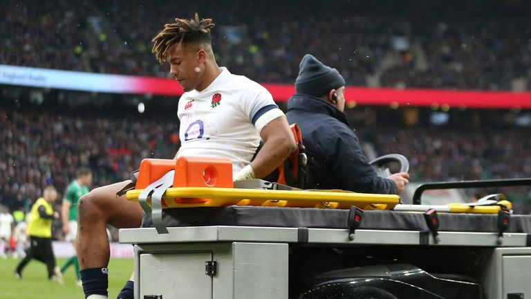 England's Anthony Watson goes off injured during the NatWest Six Nations match against Ireland