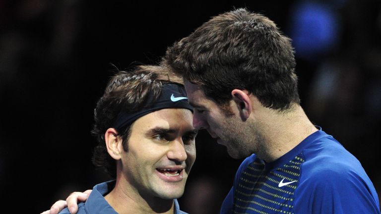 Switzerland's Roger Federer (L) talks with Argentina's Juan Martin Del Potro (R) after winning their group B singles match in the round robin stage on the sixth day of the ATP World Tour Finals tennis tournament in London on November 9, 2013. Federer won 4-6, 7-6, 7-5.