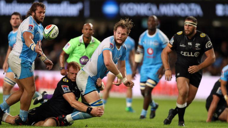 RG Snyman of the Bulls offloads the ball after a tackle by Philip van der Walt