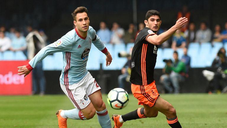 Celta Vigo's Spanish defender Hugo Mallo (L) vies with Valencia's Portuguese midfielder Goncalo Guedes