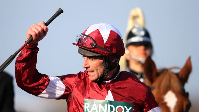 Russell celebrates his Grand National victory on Tiger Roll