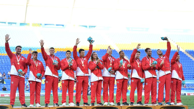 The men's team also proudly display their medals
