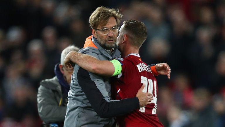 Jurgen Klopp embraces Liverpool captain Jordan Henderson after the Anfield leg