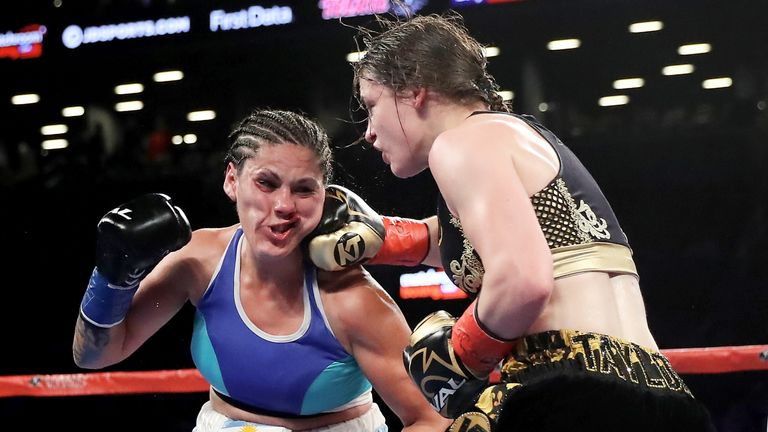 Taylor lands a right hook on Bustos