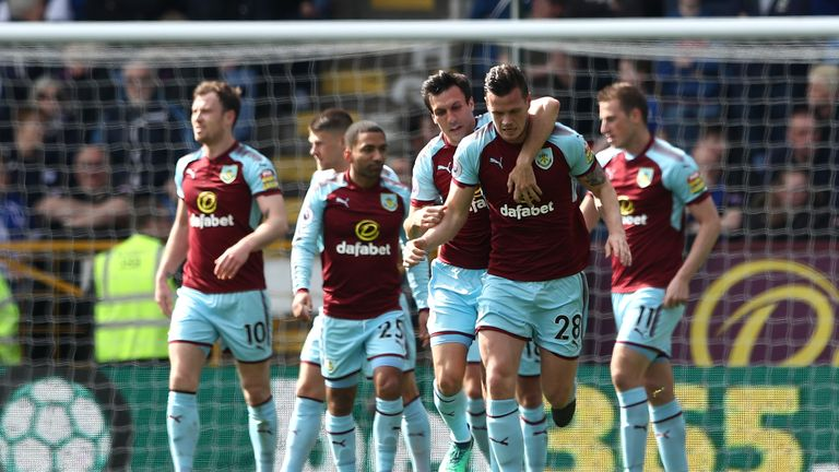 Kevin Long celebrates with teammate Jack Cork after doubling Burnley's lead at Turf Moor