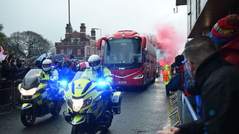 The Liverpool team bus arrives at Anfield before the game