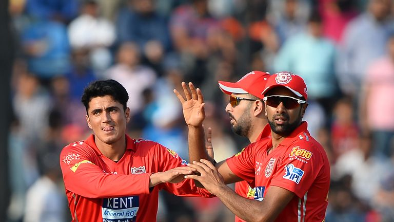 Mujeeb (L) and Ravichandran Ashwin (R) were team-mates in the IPL but could be rivals from Thursday (Credit: AFP)