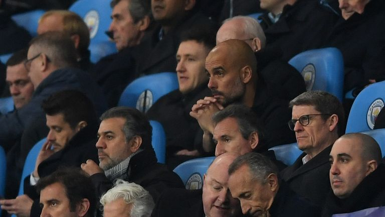 A glum Pep Guardiola looks on after being sent to the stands