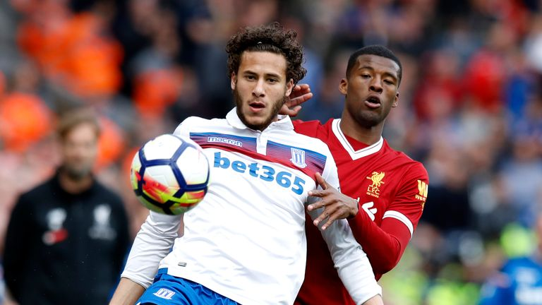 Ramadan Sobhi (left) battles for the ball with Liverpool's Georginio Wijnaldum