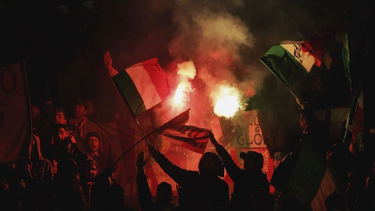 Roma supporters light flares during a European tie at the Stadio Olimpico
