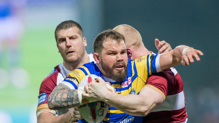 Adam Cuthbertson is tackled by Wigan's Tony Clubb and Liam Farrell
