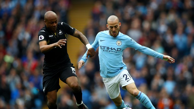 Andre Ayew and David Silva battle for the ball