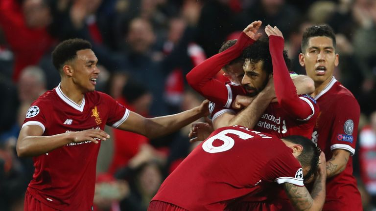 Liverpool players Mohamed Salah and Roberto Firmino celebrate during the UEFA Champions League Semi Final First Leg match between Liverpool and A.S. Roma at Anfield on April 24, 2018
