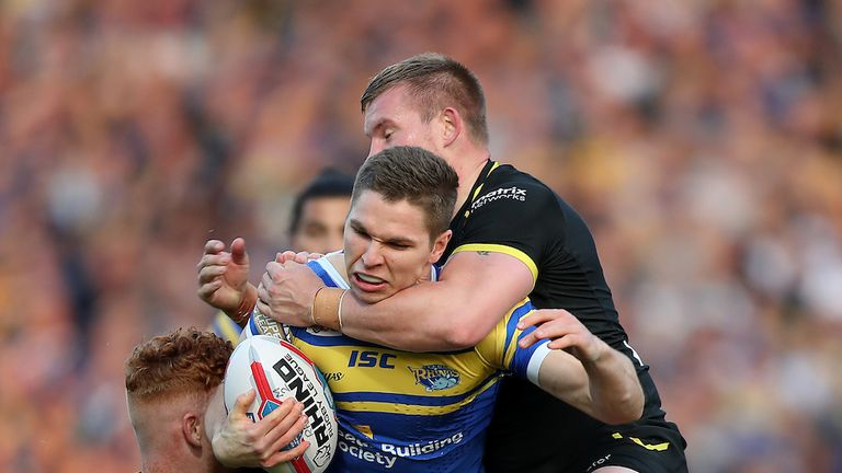 Leeds' Matt Parcell and Warrington Wolves' Harvey Livett collide