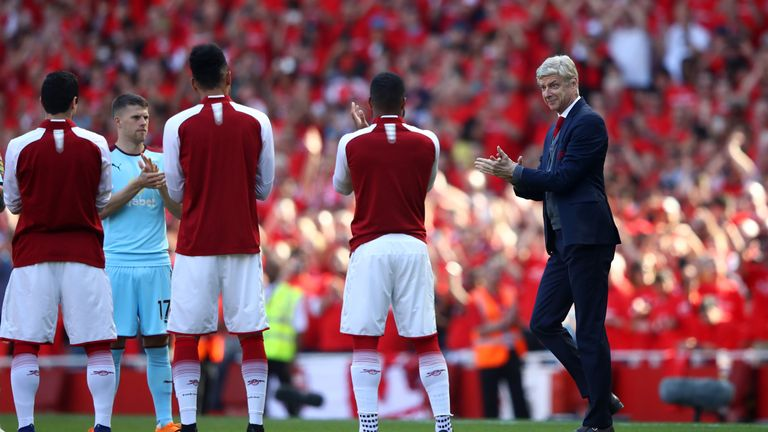 Arsene Wenger is given a guard of honour by both sets of players after the game
