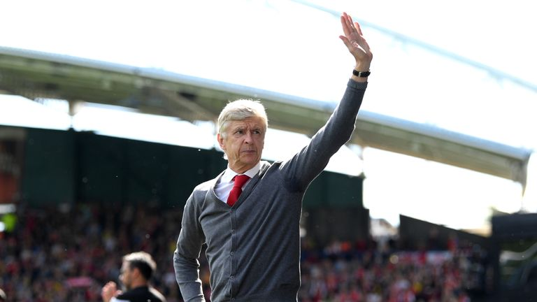 Wenger acknowledges the crowd at the John Smith's Stadium