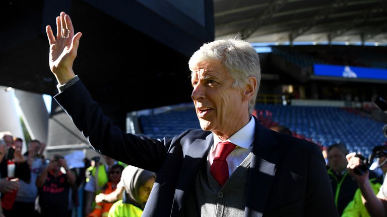 Arsene Wenger waves goodbye to the Arsenal fans after his final game in charge