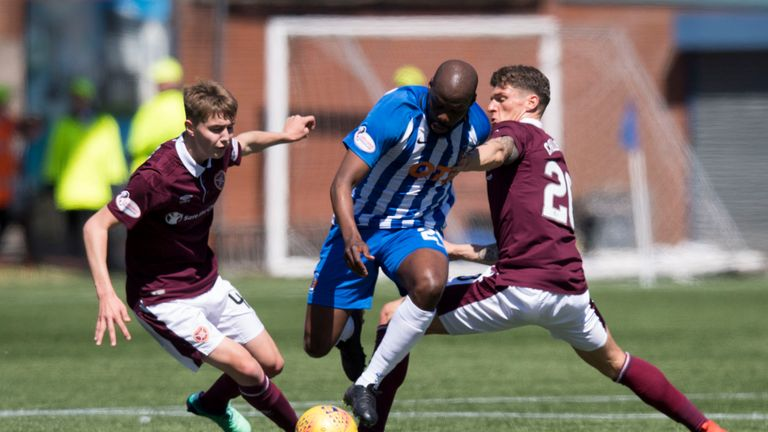 Kilmarnock's Youssouf Mulumbu battles with Hearts' Harry Cochrane and Ross Callachan
