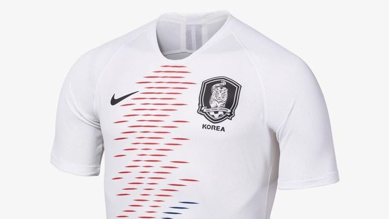 South Korea's away strip includes a red and blue pattern running down the front