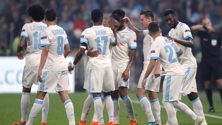 Dimitri Payet was consoled by his team-mates as went off injured in the first half