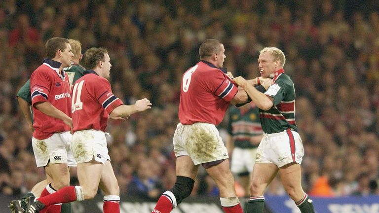 Munster's Alan Quinlan gets to grips with Leicester's Neil Back in the 2002 final