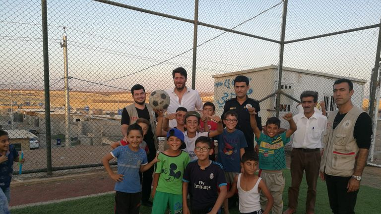 Fisher pictured during his visit to Iraq's Darashakran refugee camp