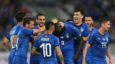 Mario Balotelli is congratulated by his team-mates after scoring the opening goal for Italy