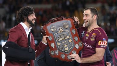 Johnathan Thurston and Cameron Smith hold aloft the Origin trophy after winning game three of the 2017 State Of Origin series