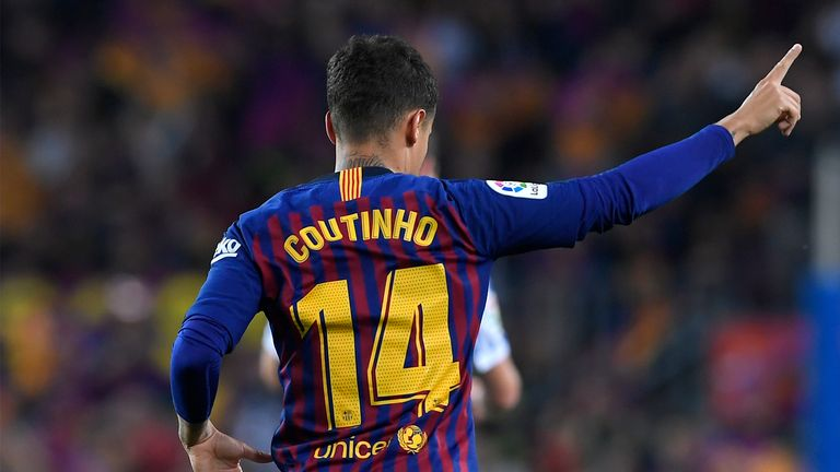Barcelona's Brazilian midfielder Philippe Coutinho celebrates after scoring a goal during the Spanish league football match between FC Barcelona and Real Sociedad at the Camp Nou stadium in Barcelona on May 20, 2018. (Photo by LLUIS GENE / AFP)        (Photo credit should read LLUIS GENE/AFP/Getty Images)