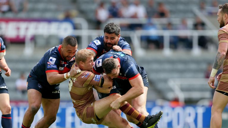 Huddersfield's Ryan Hinchcliffe is tackled during the Magic Weekend game against Wakefield