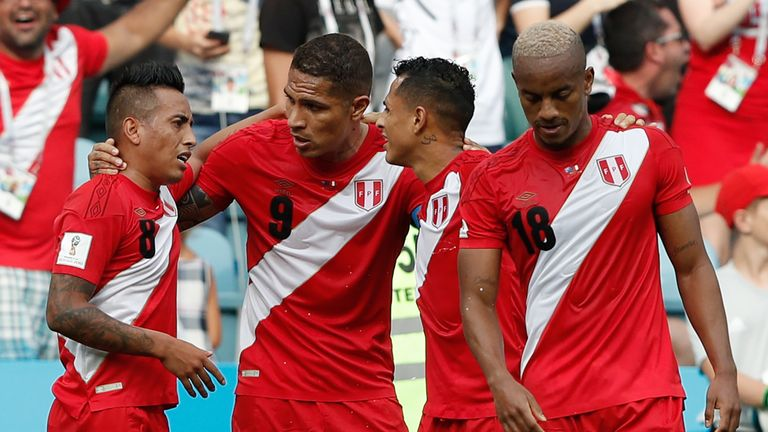 Andre Carrillo (R) celebrates with team-mates after scoring Peru's opening goal against Australia
