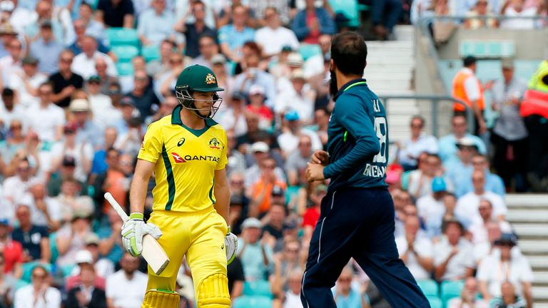 Australia captain Tim Paine trudges off the field after being dismissed by Moeen Ali