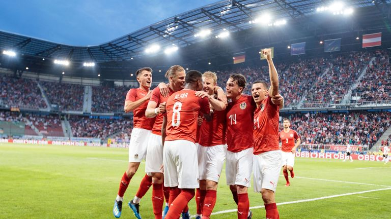 Austria beat Germany on Saturday after a lengthy rain delay