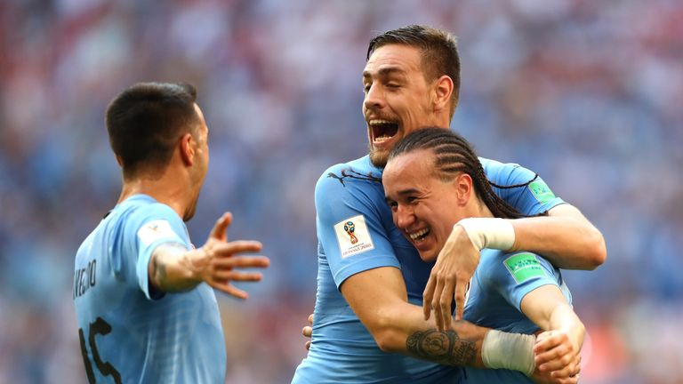 Diego Laxalt celebrates with team-mates after scoring Uruguay's second