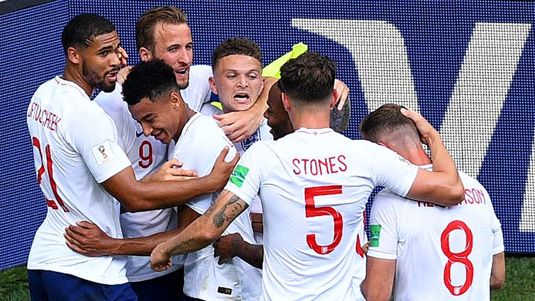 England players congratulate goalscorer Kane