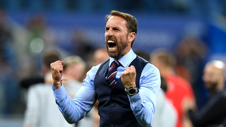Southgate celebrated the victory passionately at full time in front of the England fans