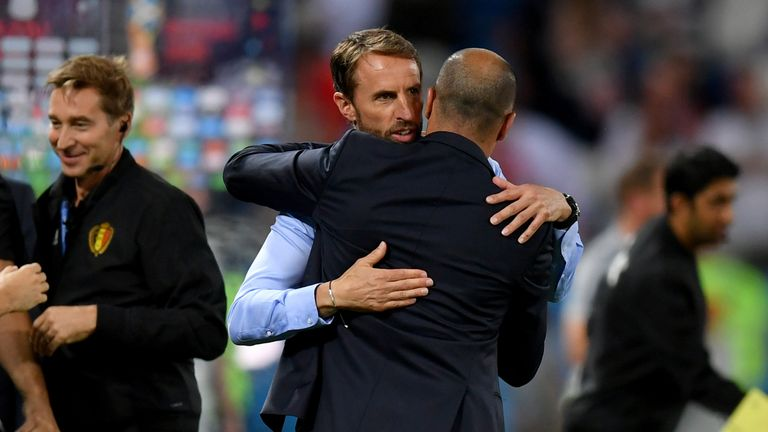 Robert Martinez and Gareth Southgate embrace on the touchline during their teams' meeting in the group stages