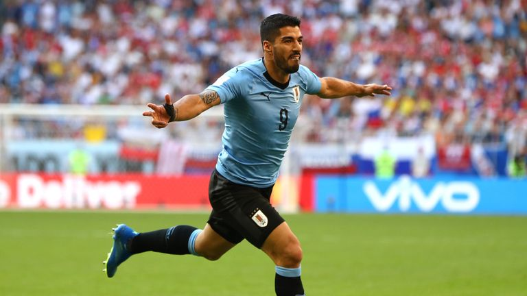 Luis Suarez celebrates his goal early in the first-half against Russia