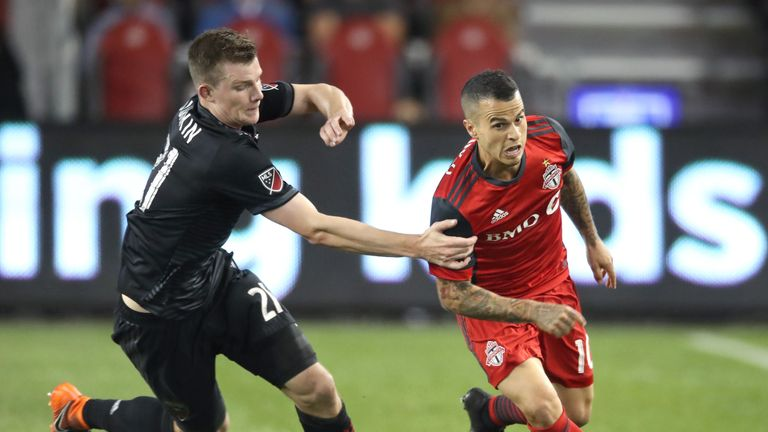 Toronto's Sebastian Giovinco (R) escapes a challenge against DC United (Pic: Tom Szczerbowski-USA TODAY Sports)
