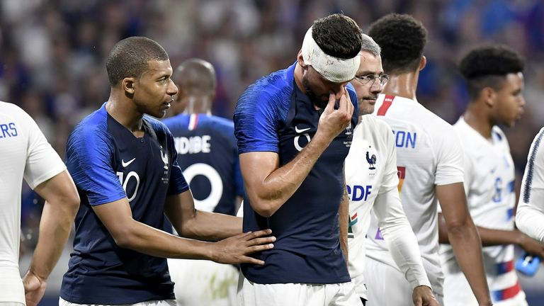 Olivier Giroud was substituted after a clash of heads with USA defender Matt Miazga