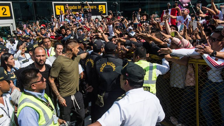 Paolo Guerrero (C) was greeted by supporters as he arrives at the Jorge Chavez airport in Lima on May 15, 2018 a day after the Court of Arbitration for Sport (CAS) increased his ban