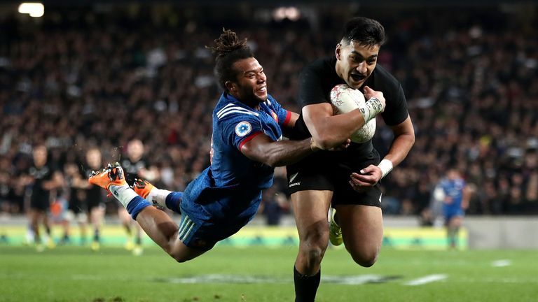 Rieko Ioane of the All Blacks scores a try despite the attentions of Teddy Thomas