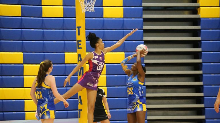 Bath's Kadeen Corbin aims for goal with Shamera Sterling towering above her