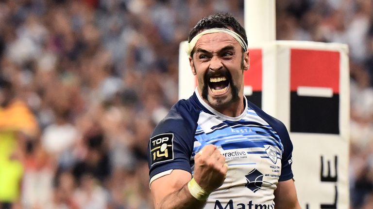 Thomas Combezou celebrates after Steve Mafi's try all but secured the title