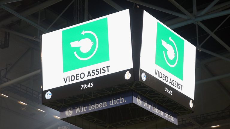 The sign for the VAR Video Assistant Referee is seen on the big screen during the DFB Cup Semi Final match between FC Schalke 04 and Eintracht Frankfurt in April