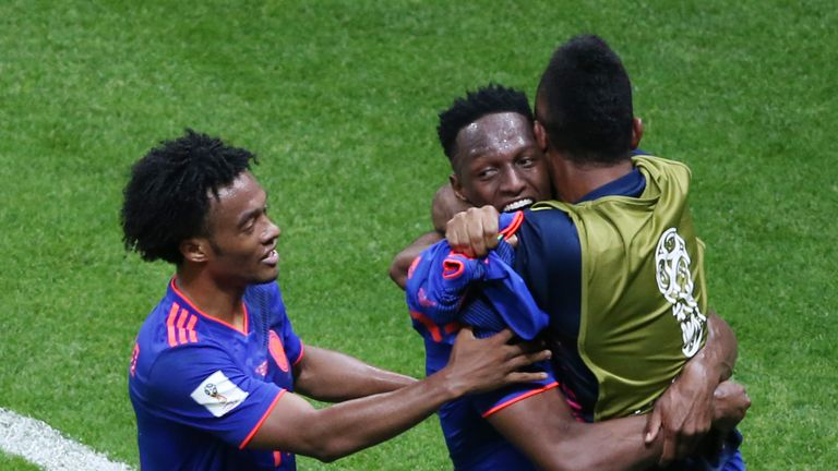 Yerry Mina celebrates scoring Colombia's opener against Poland at the World Cup